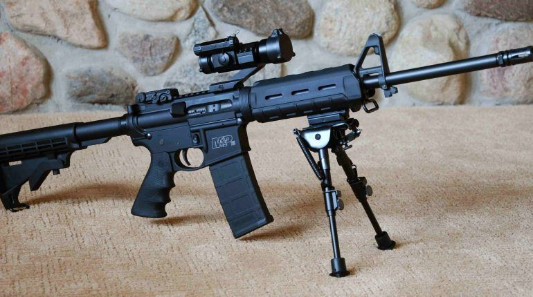 a rifle with attached bipod