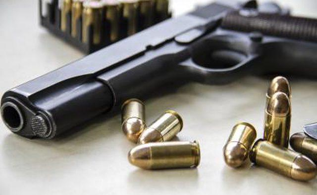 close-up photo of pistol and 45 acp
