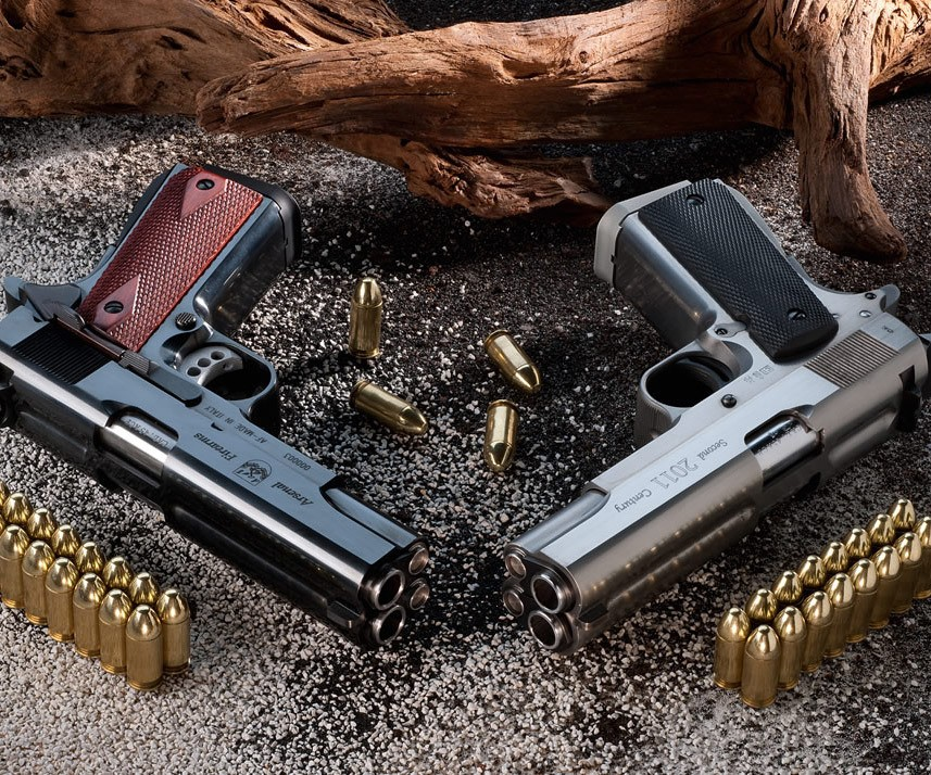 two different handguns and their bullets