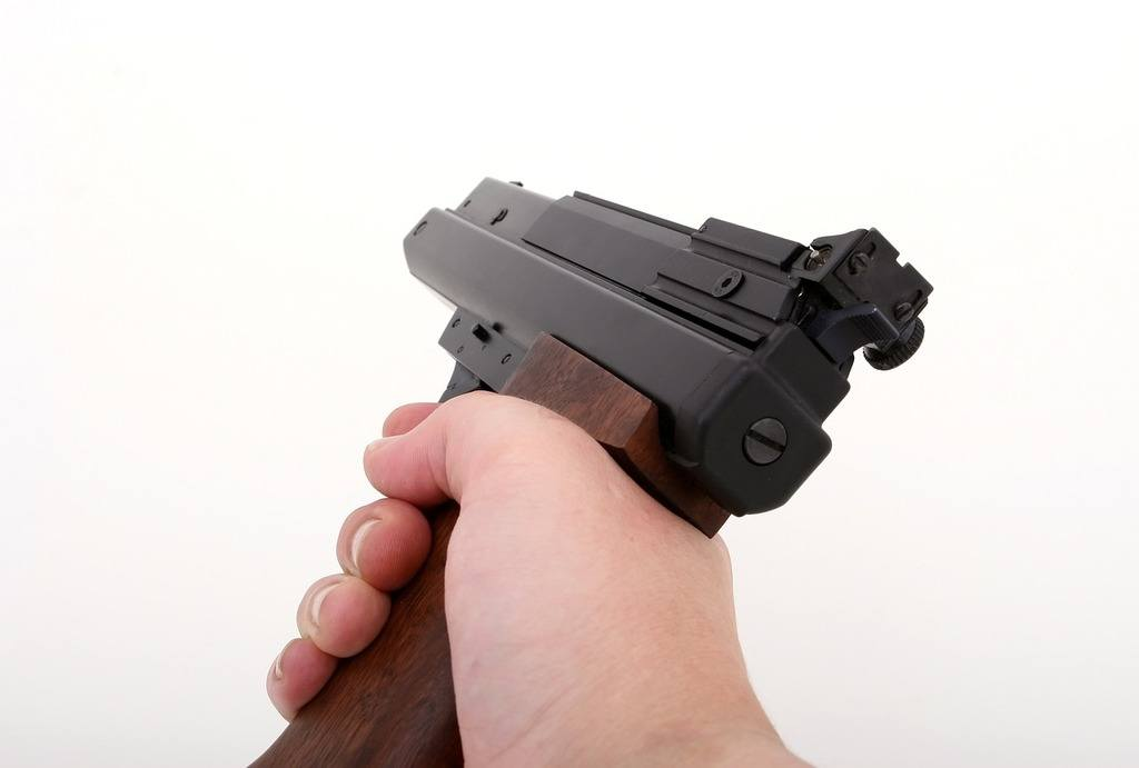 close-up photo of a handgun being pointed