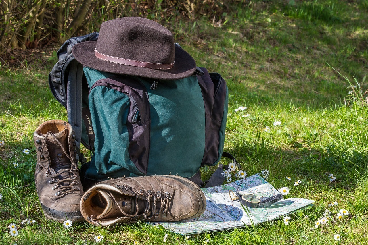 a pair of boots and a bag of other basic essentials when hunting