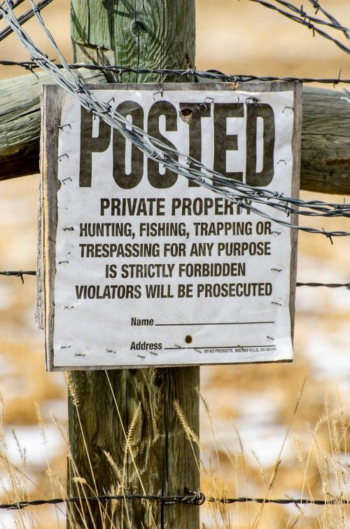 a signage placed on the fences to advise that hunting is not allowed in the area
