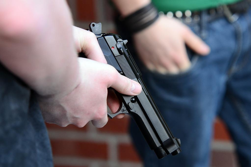 close-up photo of a pistol being held