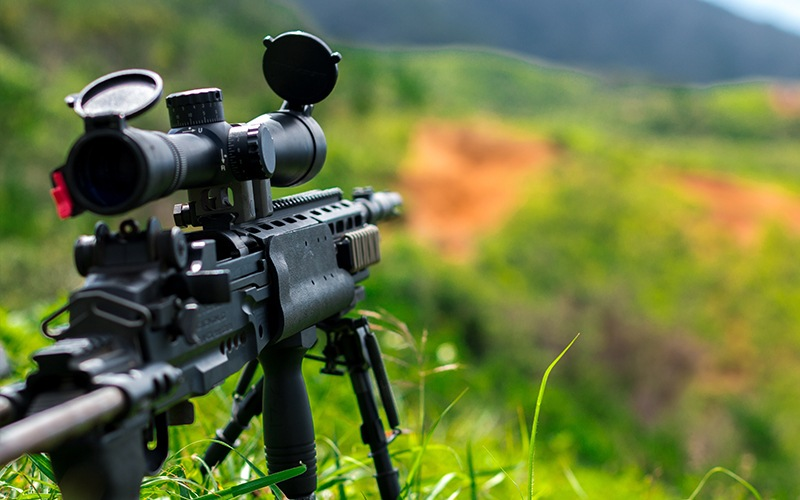 a hunting rifle with scope and bipod