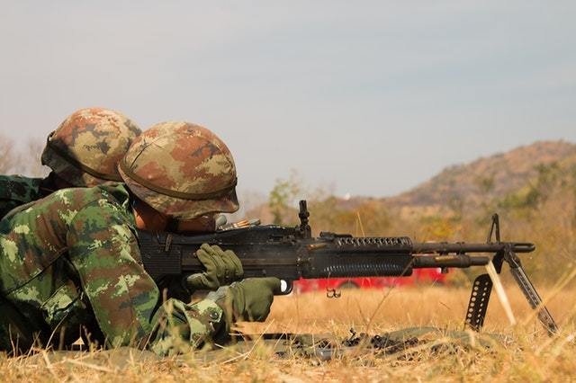 armed army using a bipod