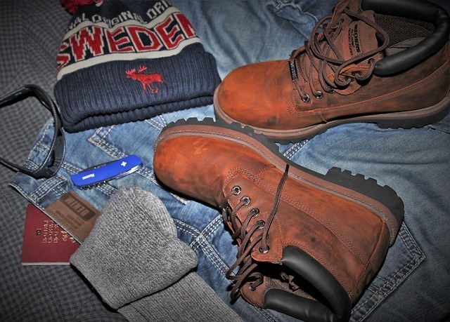 a pair of hunting boots and some accessories