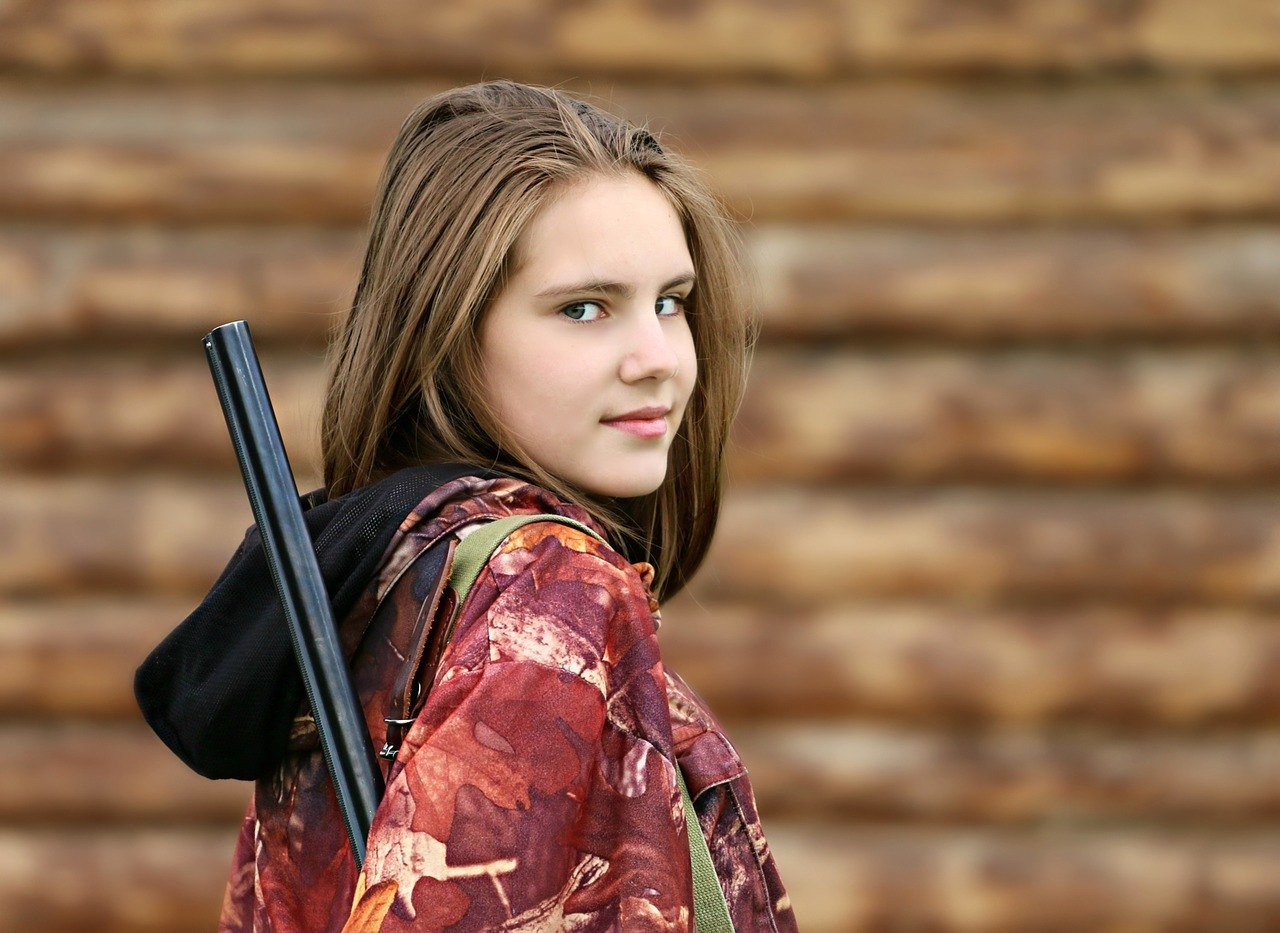 girl equipped with shotgun