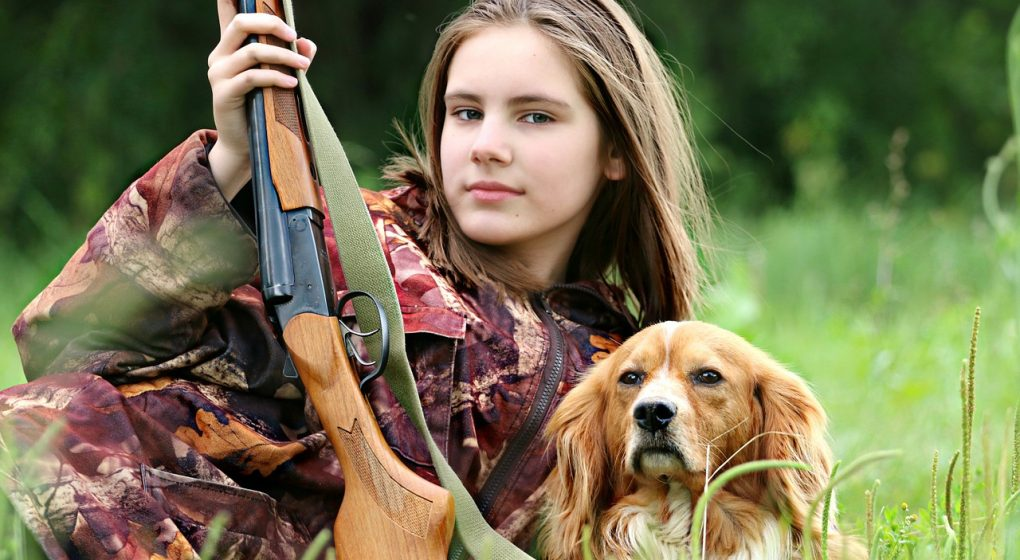 beautiful teen hunter with complete hunting supplies and gear